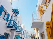 image of colorful building  - Modern white building with colorful painting detail and blue sky - JPG