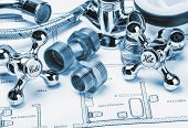 foto of mechanical drawing  - spare parts and tools lying on drawing for repair plumbing - JPG