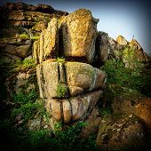 stock photo of steppes  - old crumbling granite stones in the steppe - JPG