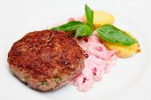 stock photo of patty-cake  - Beef patty cake with creamy sauce and potatoes - JPG