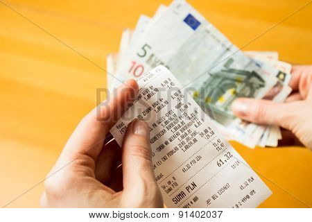 Receipt And Money In Woman Hand