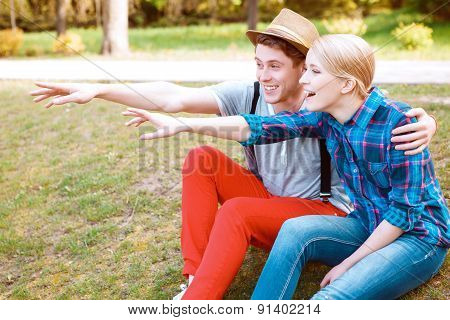 Couple pointing somewhere with excitement