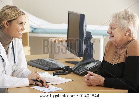 Doctor talking to senior woman patient