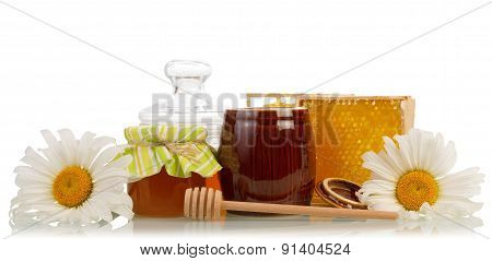 Honeycomb with flowers and dipper