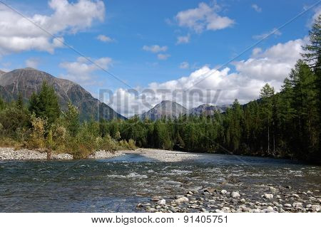 Summer day on the mountain river.