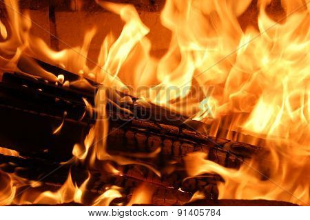 Burning wood in the fireplace.