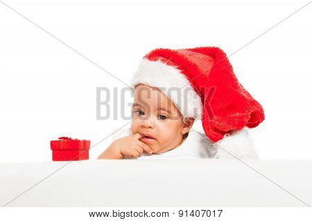 African baby paci finger wearing red Christmas hat