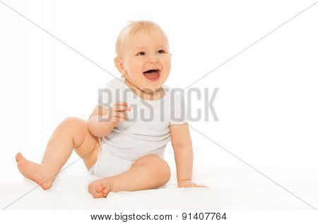Portrait of happy laughing baby in white bodysuit