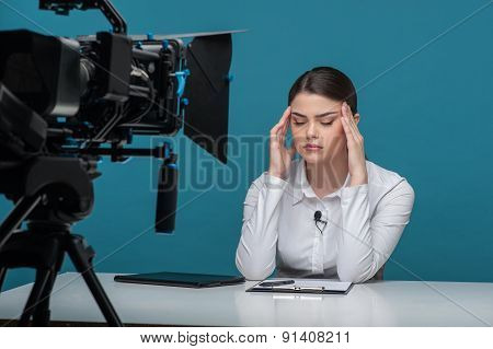 Beautiful girl tv newscaster is very tired