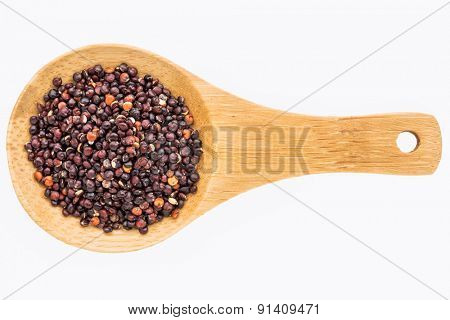 gluten free, black quinoa grain on a small wooden spoon isolated on white