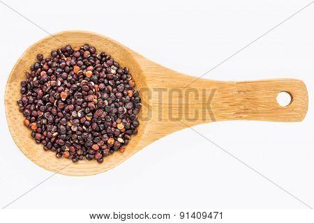 gluten free, black quinoa grain on a small wooden spoon isolated on white