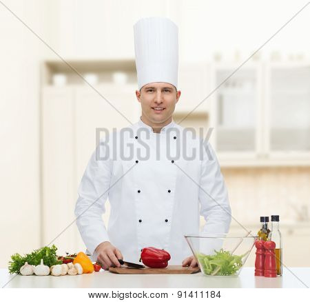 profession, vegetarian, food and people concept - happy male chef cooking vegetable salad over kitchen background