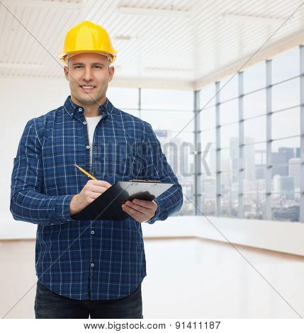 repair, construction, building, people and maintenance concept - smiling male builder or manual worker in helmet with clipboard taking notes over empty flat background