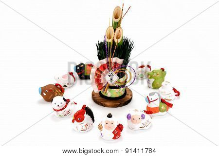 Figurines Of The Zodiac And New Year's Pine.