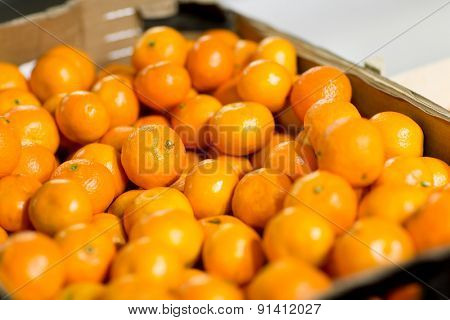 sale, shopping, vitamin c and healthy food concept - ripe mandarins at grocery market or farm