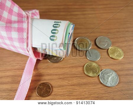 Banknotes In Purse With Coins Of Thai Baht Money On Wood Background