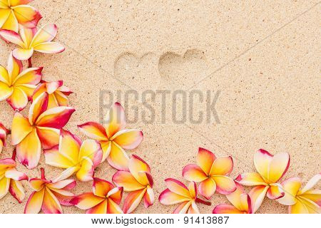 Two Heart Print On Sand With Frangipani Flowers, Top View, Horizontal Composition