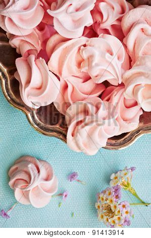 Pink Meringue On Plate On Blue Background, Macro, Selective Focus, Top View