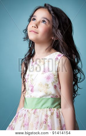 Image of nice little girl posing looking up