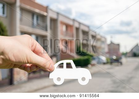 Hand Holds Cut Out Paper Car As Symbol Of Leasing