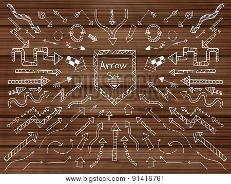 Hand drawn arrow icons set on wooden texture. Vector Illustration