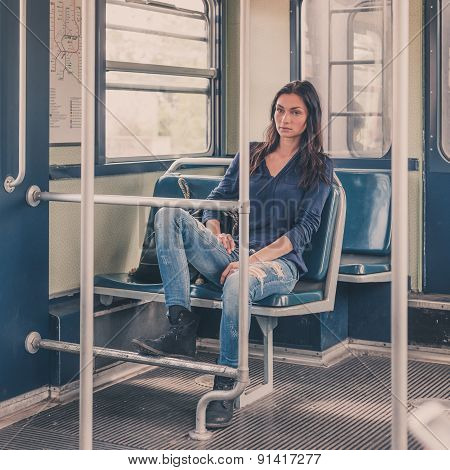 Beautiful Girl Posing In A Metro Car