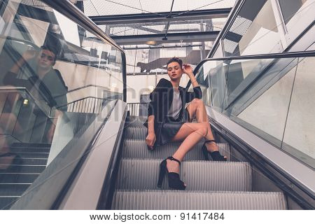 Beautiful Girl Posing On An Escalator