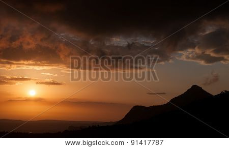 Mountain Range And Dramatic Sky During Sunset