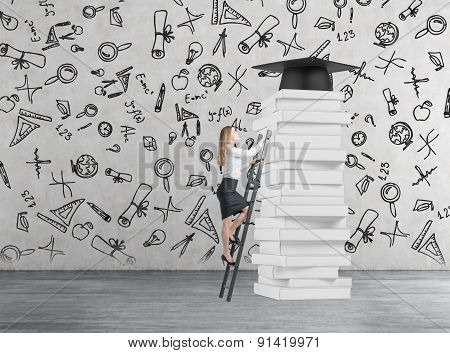 Young Lady Is Climbing Up To Get University Degree. Pile Of Book And A Graduation Hat As A Prize.