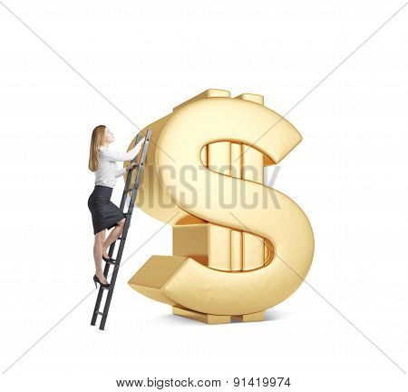 Young Lady Is Climbing On The Huge Golden Dollar Sign. Isolated.
