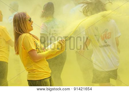 One Of The Official Woman Squirting Yellow Color Powder On The Runners