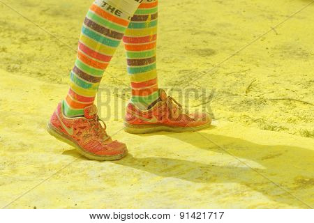 The Colorful Shoes And Legs Of One Of The Officials