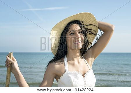 Beautiful Girl Smiling On The Beach