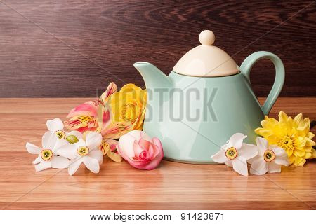 Light Blue Teapot With Flowers