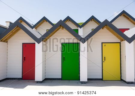 Colourful Doors Of Yellow, Red And Green, , With Each One Being Numbered Individually, Of White Beac