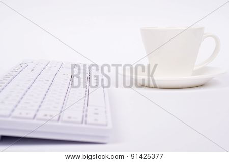 White keyboard and cup