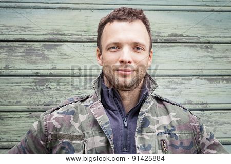 Young Caucasian Man In Camouflage. Outdoor Portrait