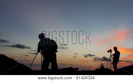 Silhouettes of landscape photograhers.