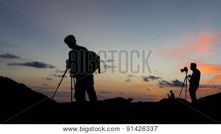 Silhouettes of landscape photographers.