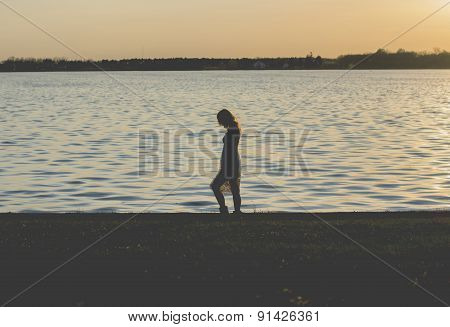 Blond Woman Walking By The Lake