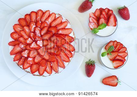 Delicious traditional celebration strawberry cake sweet dessert food with fresh strawberries on whit