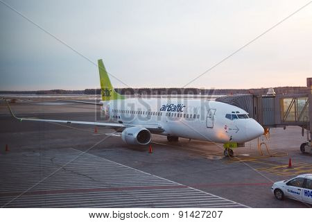 RIGA, LATVIA - MARCH 5: Air Baltic Boeing 737 airliner at Riga airport, March 5th 2014. Air Baltic is the Latvian flag carrier airline.