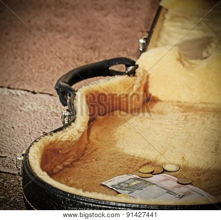 Euro Coins And Bills In A Guitar Case