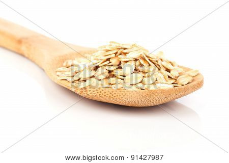 Cornflakes In Wooden Spoon, Isolated On White Background