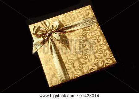 Gift in gold wrapping