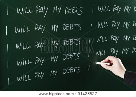 I will pay my debts sentence written repeatedly on blackboard as a punishment