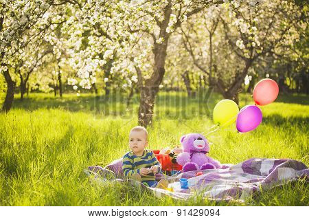 Family Picnic.child Sitting Among Toys