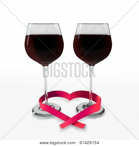 Two glasses of good red wine and a ribbon heart shaped
