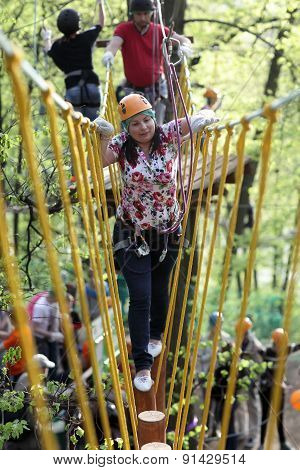 Woman On A Rope Climbing