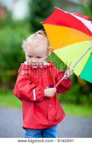 Toddler Girl With Umbrella Outdoors On Rainy Day